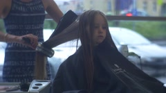 Woman-Hairdresser is Engaged in Hairdo of Girl - stock footage