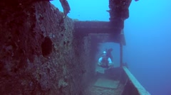 Male scuba diver inside the wreck of the SS Thistlegorm   Stock Footage