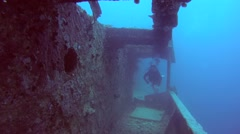 Female scuba diver inside the wreck of the SS Thistlegorm   Stock Footage