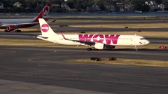 Wow Airlines plane, airport runway departure Stock Footage