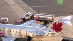Gas truck fuels jet plane, airport gate Stock Footage