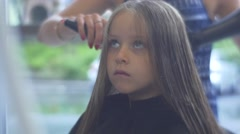 The Little Girl Has Visited a Hairdressing Shop in the Capital Boulevard Stock Footage