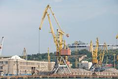 Cargo cranes on rails Stock Photos