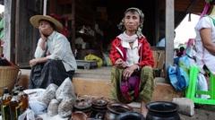 Padaung woman selling handmade on market in Loikaw, Myanmar - stock footage