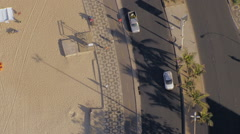 Flying directly above Ipanema Beach mosaic sidewalk, Rio De Janeiro - stock footage