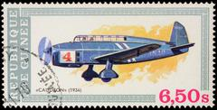 Old aircraft Caudron (1934) on postage stamp - stock photo