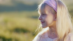 Portrait in profile of a blonde girl of 5 years Stock Footage