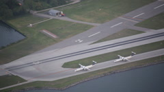 Aerial view of a plane landing on the runway Stock Footage