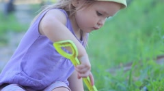 Girl Playing in the Sandbox With Shovel - stock footage