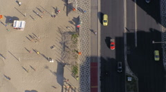 Flying directly above Ipanema Beach mosaic sidewalk with palms, Rio De Janeiro - stock footage