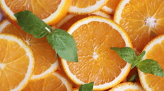 Plenty of orange slices with mint leaves Stock Footage