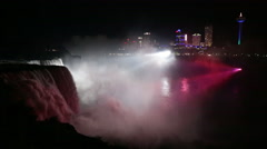 Niagara Falls lit up at night in white lights Stock Footage