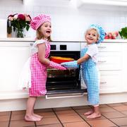 Kids baking apple pie - stock photo