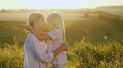 Mom plays with her daughter 5 years. In the meadow at sunset Stock Footage