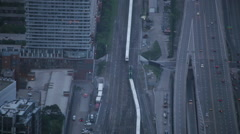 Aerial view of two trains passing in the city - stock footage