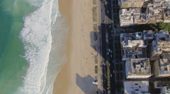 Flying directly above Ipanema Beach buildings and ocean, Rio De Janeiro - stock footage