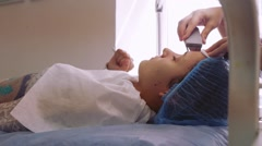Woman receiving cleansing therapy with a professional ultrasonic equipment in Stock Footage