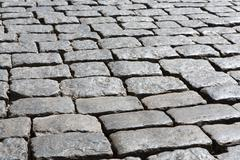 Stone paving texture. Abstract old pavement background Stock Photos