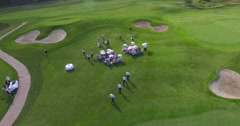 People on the golf course aerial view - stock footage