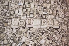 Close up of typeset letters with the word Goodbye - stock photo