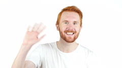Red hair man doing video call , video conference , white background - stock footage