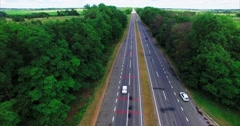 Flying Over the Road in the Forest Stock Footage