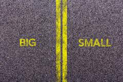 Tarmac with the words big and small Stock Photos