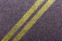 Tarmac design with diagonal double yellow lines Stock Photos