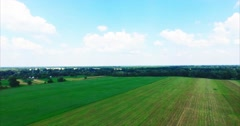 Flight Over a Large Green Field in the Village - stock footage