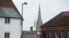 Salisbury cathedral: the spire and a union jack Stock Footage