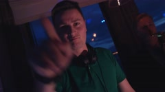 Dj dance at turntable on party in nightclub look in camera. Man play saxophone Stock Footage