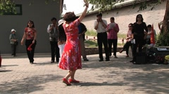 Chinese woman performs outdoor dance in Beijing, China. Stock Footage