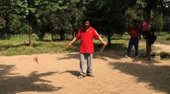 Chinese man plays diabolo in a park in Beijing, China. Stock Footage