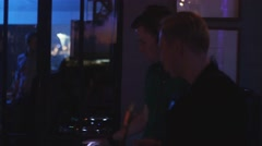 Dj spinning at turntable. Man play saxophone. Party in nightclub. Holidays - stock footage