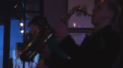 Dj spinning at turntable. Man play saxophone. Party in nightclub. Dancing. Cheer - stock footage