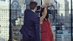 4K Young romantic couple dancing by the window in New York City apartment - stock footage