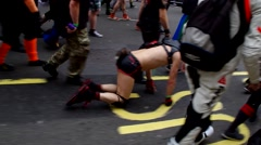 A person dressed as a puppy walks on all fours between other participants  Stock Footage