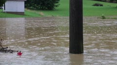 Isolated Shot of Power Pole Standing in Flood Waters Stock Footage