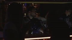 Bartender give terminal for payment to girl at bar stand on party in nightclub Stock Footage