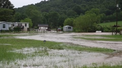 Flood Waters Surrounding Mobile Home on Farm Stock Footage