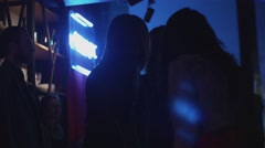 Girls speaking on party in nightclub. Dance. Blue lights. Dress. Holidays - stock footage