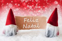 Red Christmassy Gnomes With Card, Feliz Natal Means Merry Christmas - stock photo