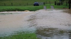 Torrential Flood Waters Pass over Gravel Drive - stock footage