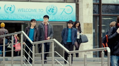 Students enter and leave the University building. Stock Footage