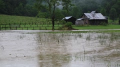 Flood Waters Surround Old Barn on Farm - stock footage