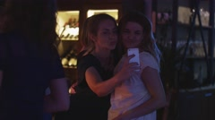 Happy woman take selfie on smartphone at party in nightclub. Holidays. People - stock footage