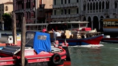 Venice Italy, delivery barge & vaporetto travel along the Grand Canal. - stock footage