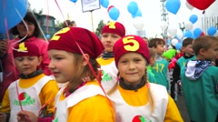 Children on a festival with balloons. Stock Footage