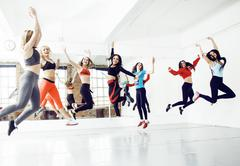 Women doing sport in gym, healthcare lifestyle people concept, modern loft Stock Photos