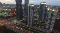 Pan up towards large residential complex with road traffic Stock Footage